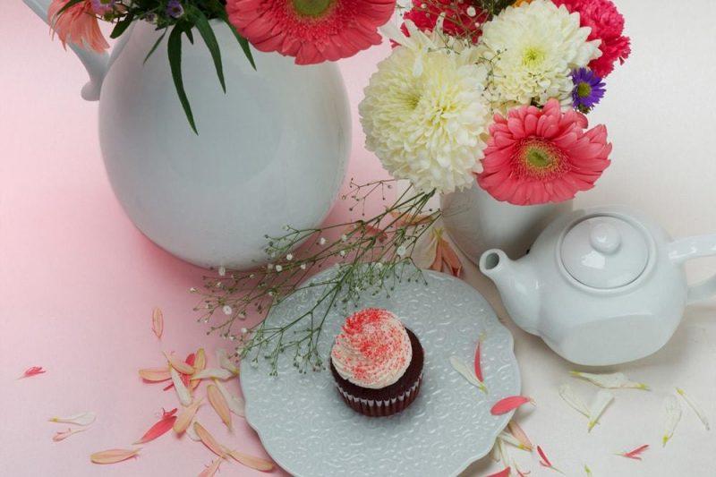 Enjoy tea beside colorful flower pots